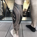 Polynesian inspired half leg sleeve over calf