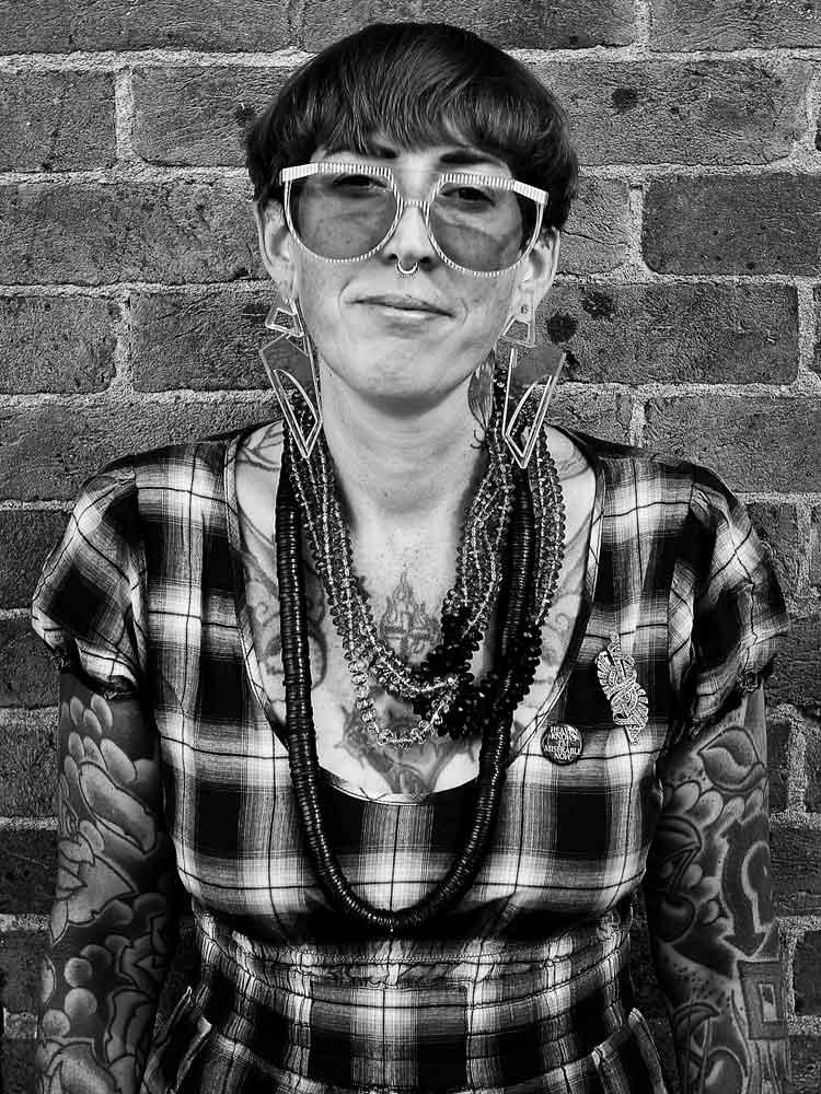 Tattoo artist Zoe Binnie standing outside 1770 Tattoo studio