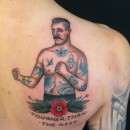 traditional tattoo of boxer with tattooes and flower below with the words tougher than the rest