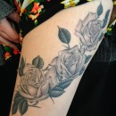 fine line black and grey roses tattoo on thigh