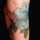 blue peony tattoo on leg