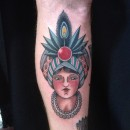 traditional gypsy head woman on forearm with big hat and jewel with feathers
