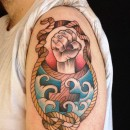 traditional tattoo of wooden female gender symbol femininity with a clenched fist in the centre both rising out of blue ocean waves inside of a rope know frame
