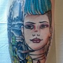tattoo of blue haired punk girls head with factory silhouettes in the background and a green steam train next to her