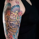 Kapala Tibetan skull tattoo on top of arm with wings full colour