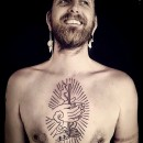 chest tattoo of two hands starting a fire with a stick in simple line work