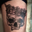 black and grey realism skull and crown tattoo