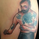 colour tattoo of bare knuckle boxer with tattoos and cigarette hanging out of mouth