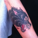 traditional style wolf head tattoo in colour